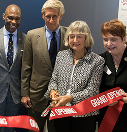 Joan Peirce cuts the ribbon for the new center.
