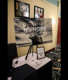 "Honors ""education is a journey: take the helm"" poster with image of a ship."