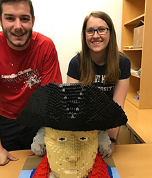 Hannah Arnold and Andrew Mason with their LEGO bust of Robert Morris.